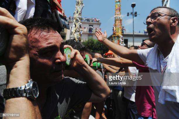 Men carry a 25metre tall wood and papiermache statue called 'giglio' during the annual Festa dei Gigli on June 25 2017 in Nola Italy When St Paolini...