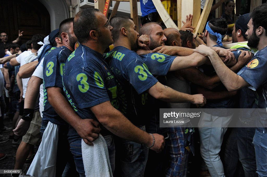 Men carry a 25-metre tall wood and papier-mache statues called 'giglio' during the annual Festa dei Gigli ('The Lily Festival') on June 27, 2016 in Nola, Italy. When St. Paolini, (355- 431 AD) the bishop of Nola, returned in a boat after freeing the town's men from captivity at the hands of the Saracens, he was welcomed by the population with lilies ('gigli'). To carry the Gigli, 128 men, called 'paranza,' shoulder one another and walk slowly through the town. In 2014 the famous festival became a UNESCO World Heritage site.