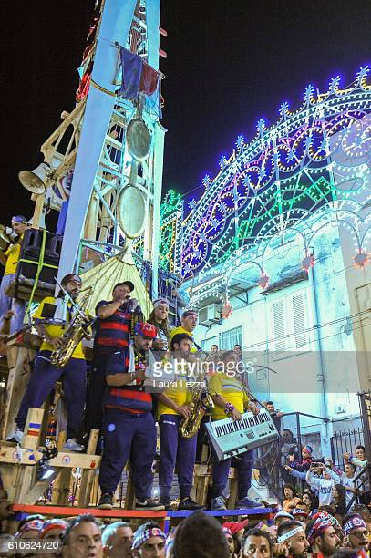 Men carry a 25metre tall wood and papiermache statues called 'giglio' during the annual Festa dei Gigli di Barra on September 26 2016 in Naples Italy...