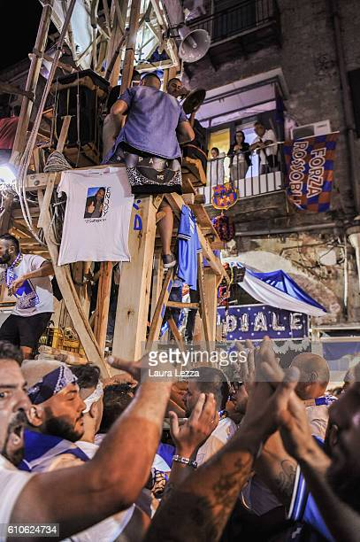 Men carry a 25metre tall wood and papiermache statues called 'giglio' during the annual Festa dei Gigli di Barra on September 25 2016 in Naples Italy...