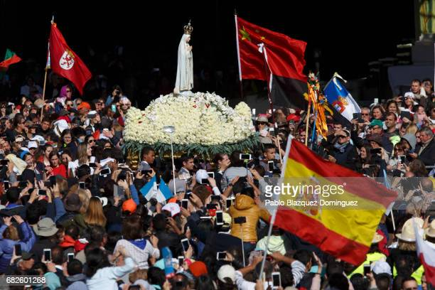 Men carry a figure representing Our Lady Of Fatima during a procession before the ceremony of canonization at the Sanctuary of Fatima on May 13 2017...
