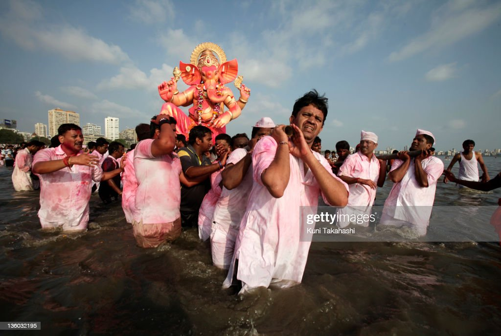Men carry a Ganesha idol into the ocean for immersion on the last day of Ganpati festival, September 22, 2010 in Mumbai, India. The 10-day Hindu festival, celebrating the birthday of Lord Ganesha who is widely worshiped as the god of wisdom, prosperity and good fortune, attracts tens of thousands people.