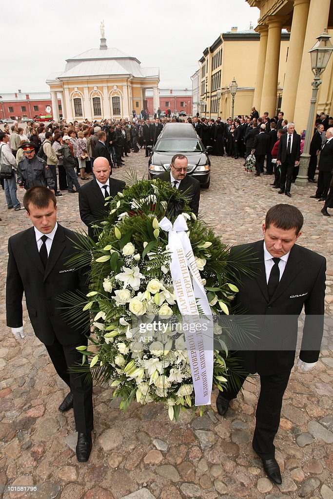 Men carry a wreath in front of the hearse with the coffin of Grand Duchess Leonida Georgievna of the Romanov dynasty in St. Petersburg on June 3, 2010 during her funeral at the Peter and Paul Cathedral. Grand Duchess Leonida Georgievna, a senior member of Russia's Romanov dynasty, died on May 23, 2010 aged 95 after a life that saw her marry a US industrialist and then the claimant to the Russian throne. Born in 1914 before the Russian Revolution that ousted the Romanov imperial family, she had been the last surviving member of the dynasty to be born in the Russian Empire, a spokesman for the family said.