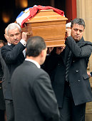Men carry on January 31 2013 the coffin of French citizen Yann Desjeux killed in the hostage rescue operation at a remote gas plant in In Amenas...