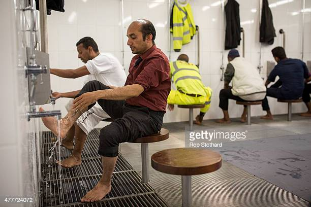 Men carry out Wudu a washing procedure in preparation for prayer at the East London Mosque before the first Friday prayers of the Islamic holy month...