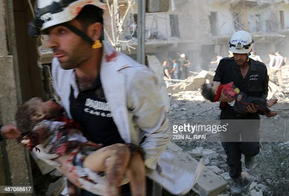 Men carry the bodies of children following a reported bombardment with explosivepacked 'barrel bombs' by Syrian government forces in the alMowasalat...