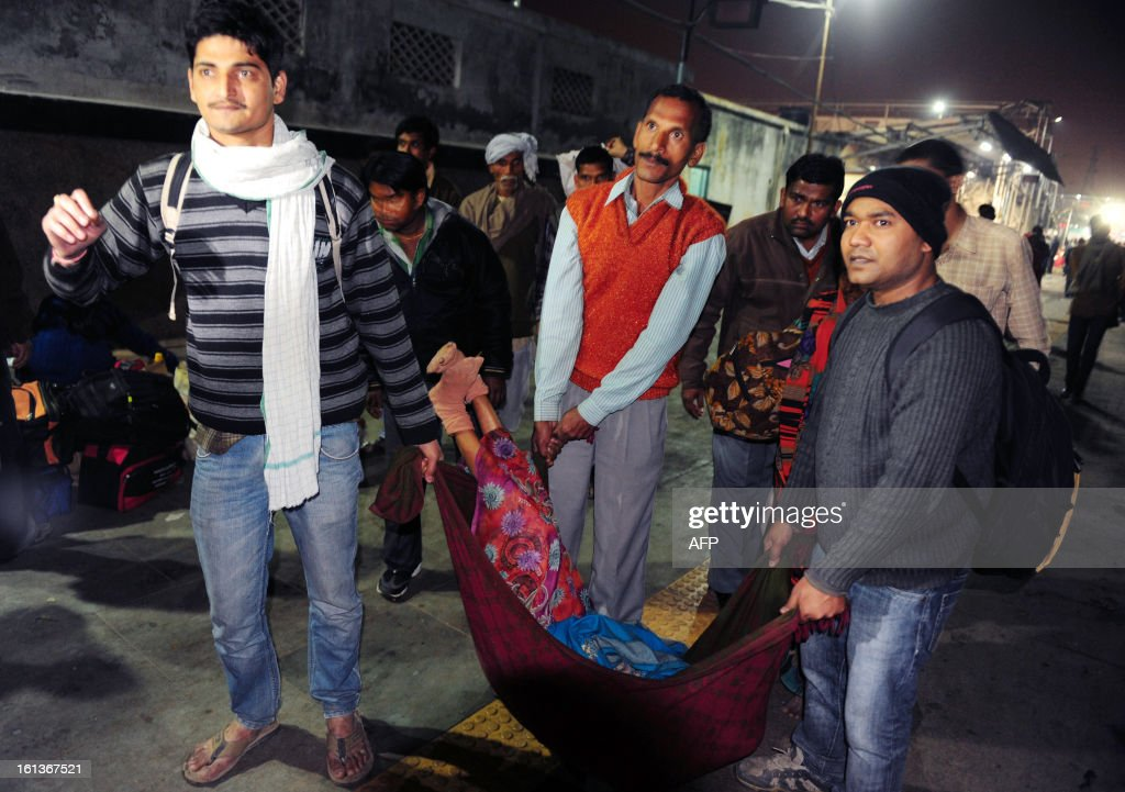 Men carry the body of one of the victims that died during a stampede at the main train station in Allahabad, on February 10, 2013. At least 10 people died in the stampede as pilgrims headed home from India's giant Kumbh Mela festival, which drew a record 30 million people to the banks of the river Ganges. The lives were lost at the main railway station where 10 corpses wrapped in white sheets could be seen on a train platform several hours after the incident which occurred in the early evening, an AFP photographer said.