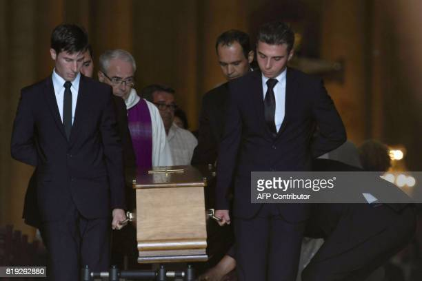 Men carry the coffin of French judge JeanMichel Lambert at the end of his funeral at the SaintJulien Cathedral in Le Mans northwestern France on July...