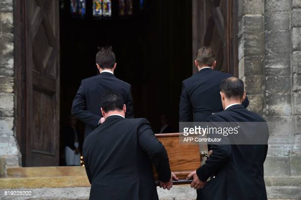 Men carry the coffin of French judge JeanMichel Lambert during his funeral at the SaintJulien Cathedral in Le Mans northwestern France on July 20...