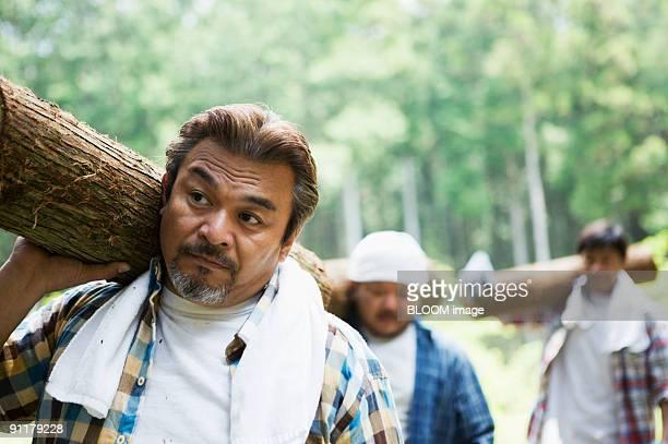 Men carrying wood