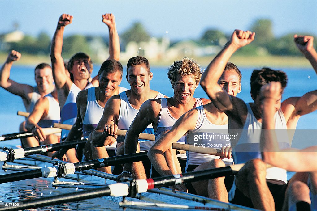 Men Celebrating Success From Sculling on River
