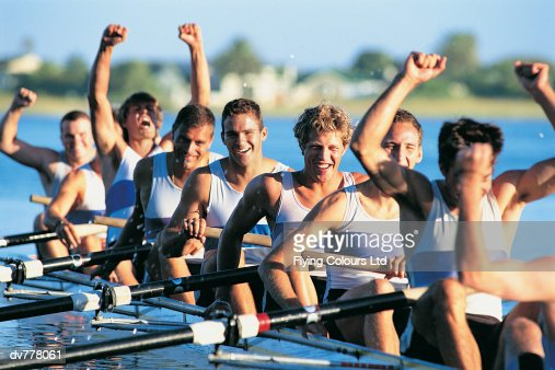 Men Celebrating Success From Sculling on River : Stock Photo