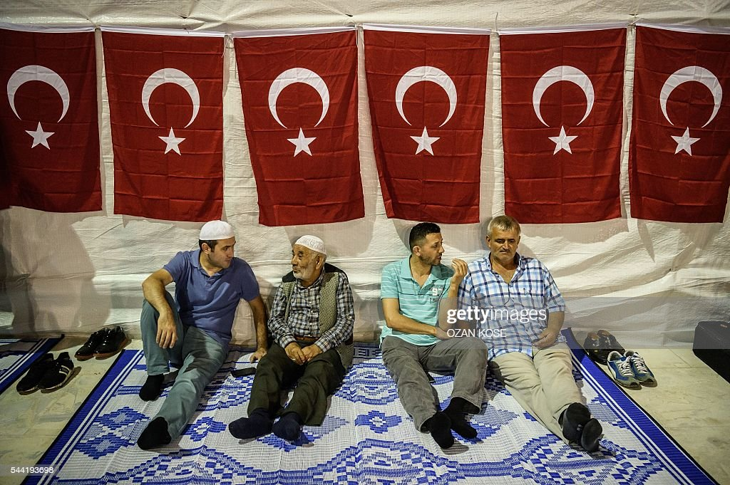 Men chat before praying at the new Camlica mosque in Istanbul on July 1, 2016. Istanbul's towering Camlica mosque received its first worshippers, as Turkey unveils the latest grand project emblematic of President Recep Tayyip Erdogan's big ambitions. Erdogan personally supervised the controversial construction of Turkey's biggest mosque -- designed to accommodate up to 60,000 worshippers and visible to all from its perch on a hill on Istanbul's Asian side. / AFP / OZAN