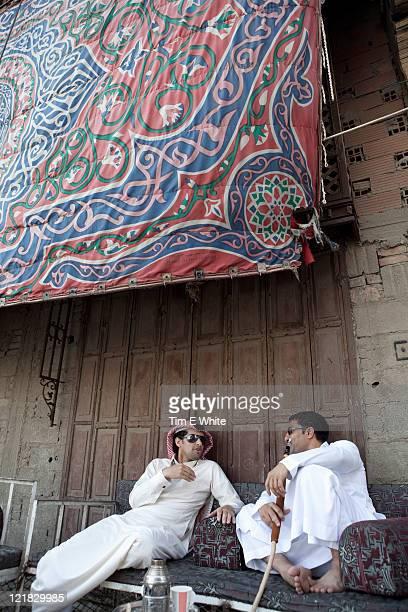 Men chatting on sofa with hookah, Al-Balad, Old town, Jeddah, Saudi Arabia, Middle East