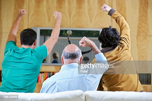 Men Cheering and Watching Soccer Game on TV