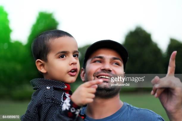 Men & child portrait in the park