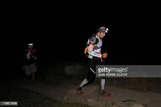 Men compete at the Italian side of the Col Ferret during the Ultra Trial race the 11th edition the Ultra Trial race a 168 km race around the Mont...