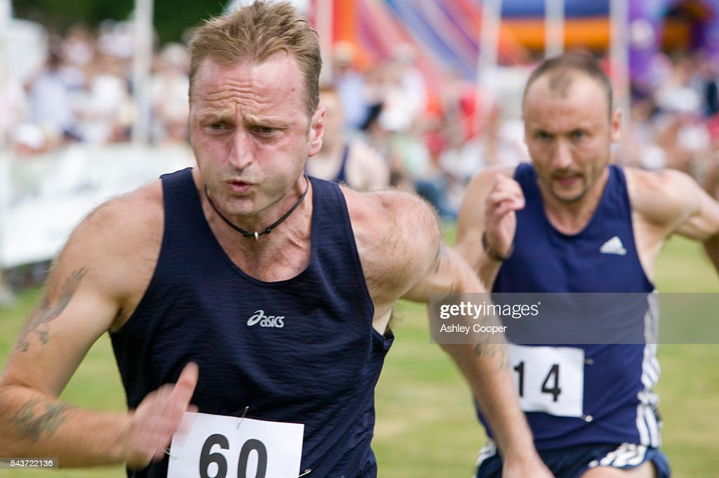 Men competing in a running competition at the annual Ambleside Sports competition at Rydal Park in the Lake District