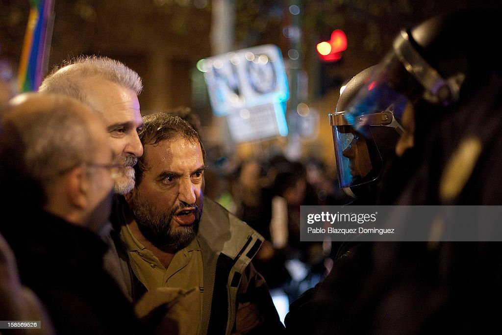 Men confront riot policemen during a health care workers demonstration outside Madrid Regional Asembly on December 19, 2012 in Madrid, Spain. As of today, health workers unions are calling for a third 48-hour strike against cuts on public health care and the privatization of medical centers and hospitals.