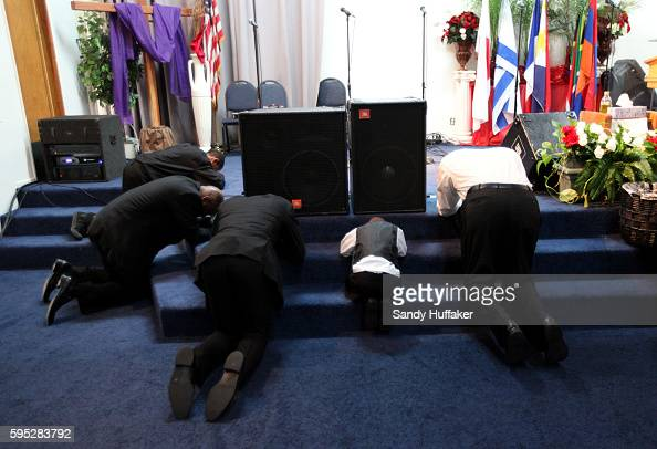 Men congregants pray at an altar during a worship service at the True Love Worship Center in Van Nuys CA on Sunday July 31 2011