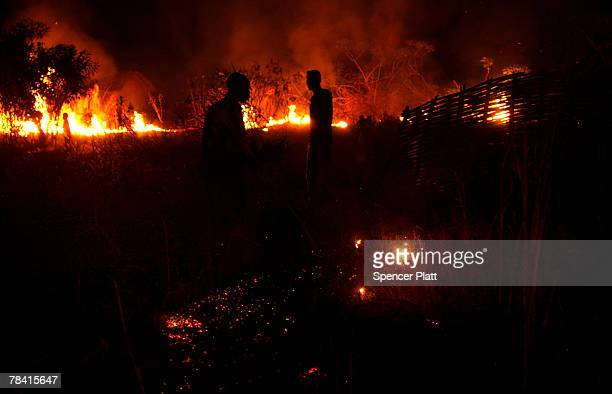 Men contain a burning field in a rebel held town December 12 2007 in Gordil in the northern Central African Republic Burning fields is common in CAR...