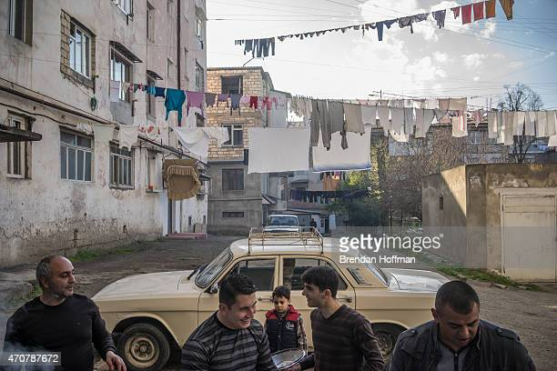 Men cook shashlik or grilled meat to celebrate one of the men's wife's birthday and his son's marriage on February 21 2015 in Stepanakert...