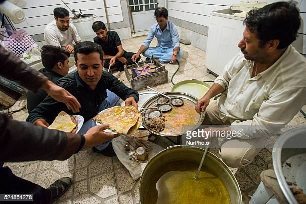 Men cooking beryun dish contains cutlet made from lamb cooked in a special small pan over open fire and enfolded in certain type of bread known as...