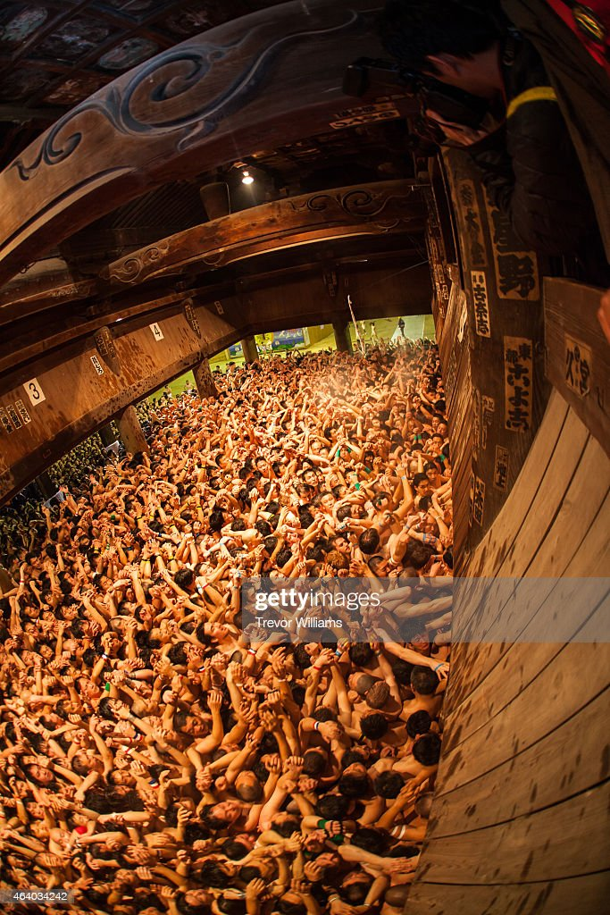 Men cram into the temple waiting for priests to drop the sacred talisman at the Hadaka Matsuri or Naked Festival at Saidaiji Temple on February 21...