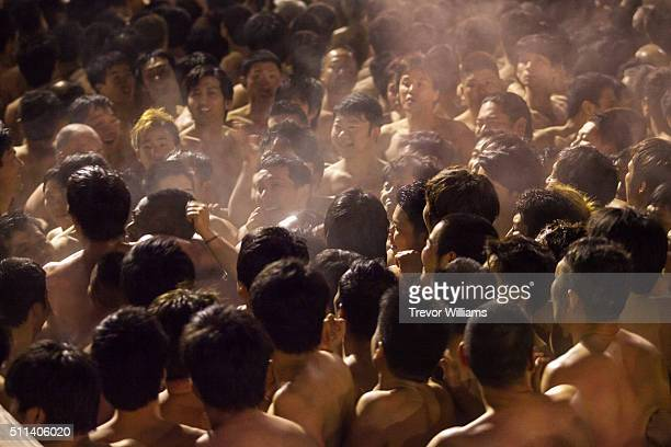 Men cram into the temple waiting for priests to drop the sacred talisman at the Hadaka Matsuri or Naked Festival at Saidaiji Temple on February 20...