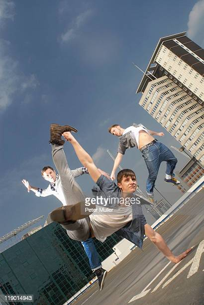 Men dancing on urban rooftop