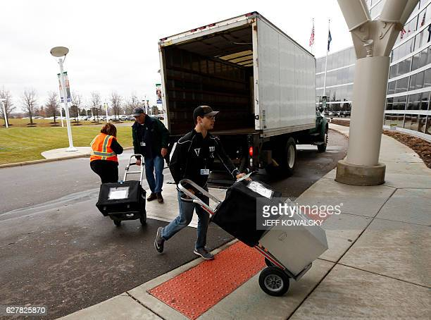Men deliver ballots that were cast in Oakland County Michigan from the 2016 US presidential race to be recounted at the Oakland County Schools...