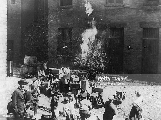 Men destroying wine and spirits in Boston during the period of prohibition