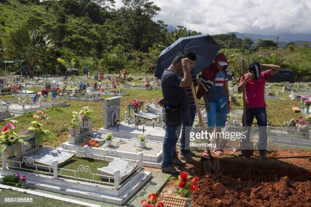 Men dig a tomb at La Ascension Normandia cemetery after landslides in Mocoa Putumayo Colombia on Monday April 3 2017 Torrential rains caused water...