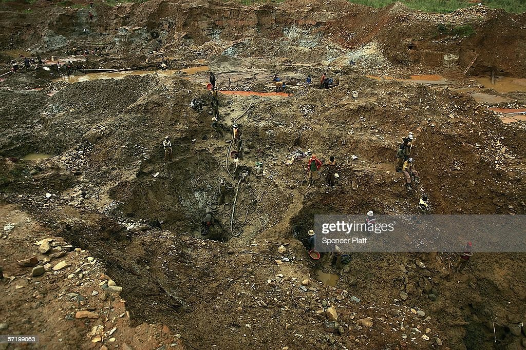 Men dig for gold at an abandoned industrial mine on March 28, 2006 in Mongbwalu, CongoThousands of Congolese scrape together meagre livings from mining. Gold and other mineral deposits, which are numerous in the volatile north-east of the country, have become a catalyst to much of the conflict in Congo. The Democratic Republic of Congo (DRC), a country that loses an estimated 1,400 people per day due to war since 1998, is struggling to hold Presidential elections this summer. The volatile East of the country, which is situated hundreds of miles from the capital Kinshasa, has been the focal point of continued violence. Numerous militias and warlords have vied for control of the mineral rich eastern Congo for decades, creating instability and continued bloodshed.