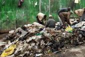 Men dig through a refuse dump in Eastleigh a predominantly Muslim Somali neighborhood on August 18 2009 in Nairobi Kenya Referred to locally as...