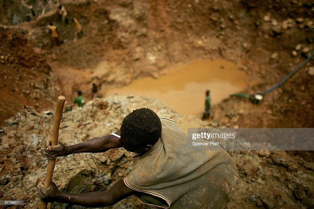 Men dig through dirt and mud while looking for gold March 28, 2006 at an abandoned industrial mine in Mongbwalu, Congo. Thousands of Congolese scrape together meager livings from mining. Gold and other mineral deposits, which are numerous in the volatile north-east of the country, have become a catalyst to much of the conflict in Congo. The Democratic Republic of Congo (DRC), a country that loses an estimated 1,400 people per day due to war since 1998, is struggling to hold Presidential elections this summer. The volatile east of the country, which is situated hundreds of miles from the capital Kinshasa, has been the focal point of continued violence. Numerous militias and warlords have vied for control of the mineral rich eastern Congo for decades, creating instability and continued bloodshed.