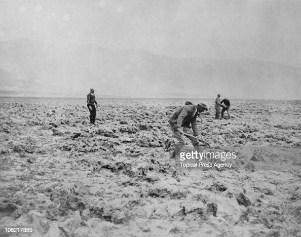 Men digging salt in a dry lake bed in Death Valley California 7th May 1930