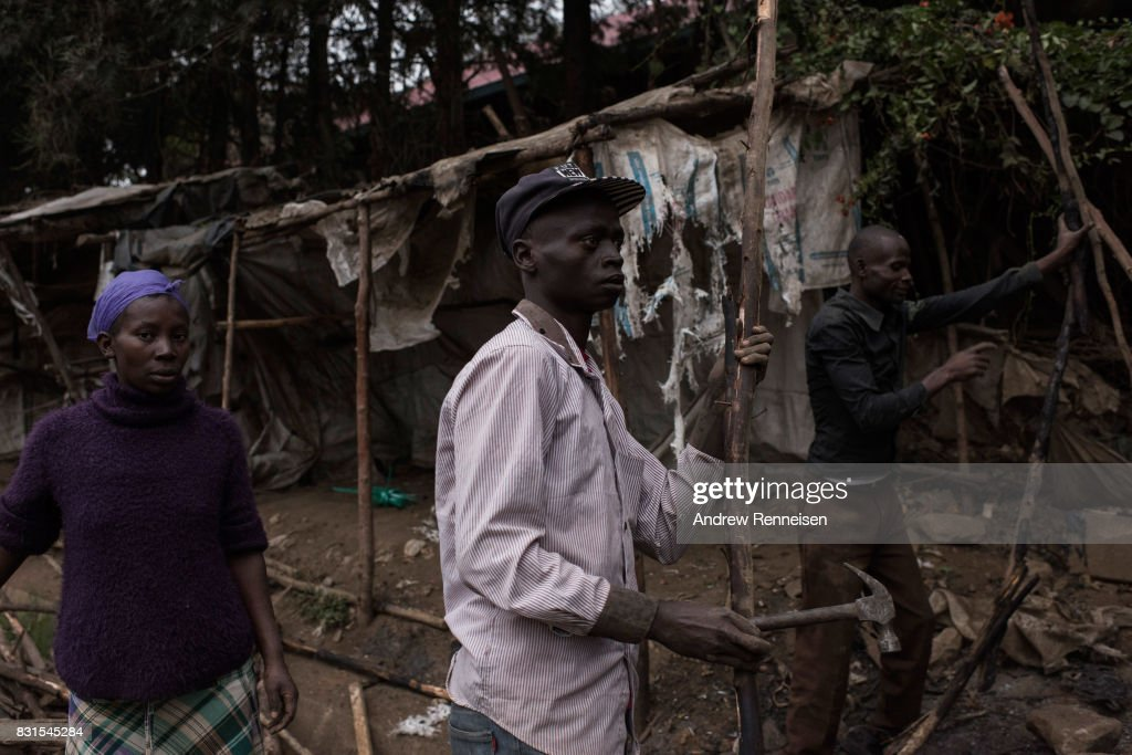 Men dismantle a roadside stand that was burnt the during unrest the day prior in the Mathare North neighborhood on August 14, 2017 in Nairobi, Kenya. Nairobi remained peaceful, but tensions remain high as oppositions supporters wait to hear from candidate Raila Odinga who has rejected the results that named Uhuru Kenyatta to his second term in Kenya's 2017 presidential election.