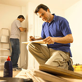 Men doing home improvement
