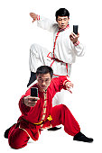 Men Doing Martial Arts and Looking at Mobile Phone