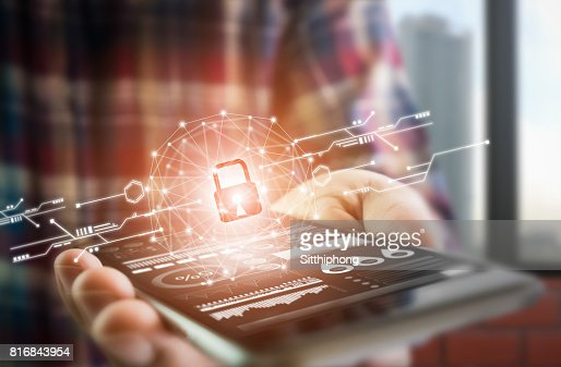 Men dress up lifestyle hold smartphone screen shows the key in the Security online world. the display and technology advances in communications. The concept of advancement in living in the future. : Stock Photo