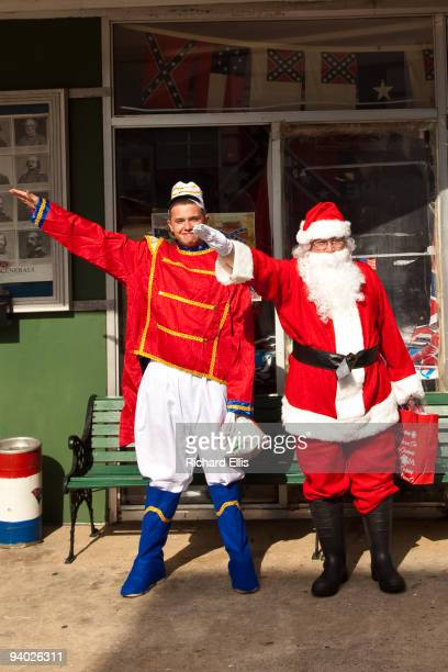 Men dressed as a Santa Claus and the tin soldier give a Nazi salute during a whitesupremacist event outside the Redneck Shop December 5 2009 in...