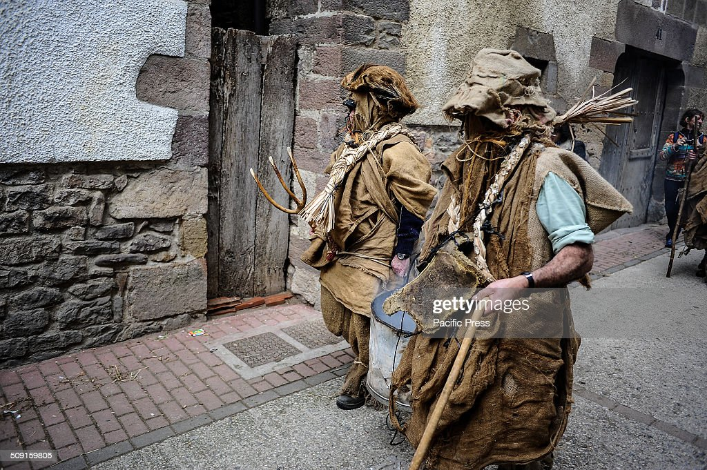 Men dressed as Caldederos prepare to take part in the ancient carnival of Lantz, in North of Navarra.
