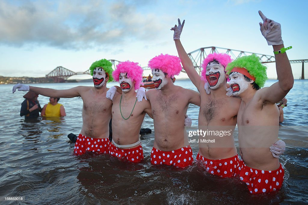 Men dressed as clowns joined over 1,000 New Year swimmers, many in costume, braved freezing conditions in the River Forth in front of the Forth Rail Bridge during the annual Loony Dook Swim on January 1, 2013 in South Queensferry, Scotland. Thousands of people gathered last night to see in the New Year at Hogmanay celebrations in towns and cities across Scotland.