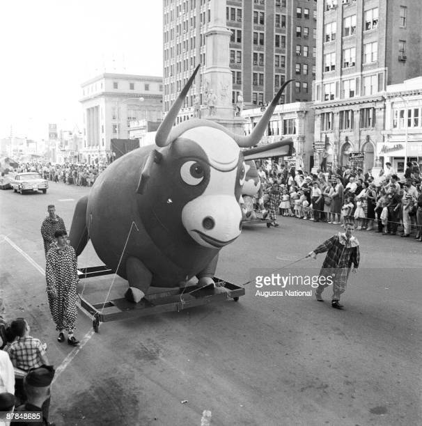 Men dressed as clowns pull a float downtown during the annual Masters Parade April 1959 in Augusta Georgia