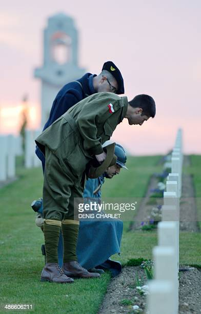 Men dressed as French soldier of the First World War look at names on graves during a dawn service at the Australian War Memorial in the northern...