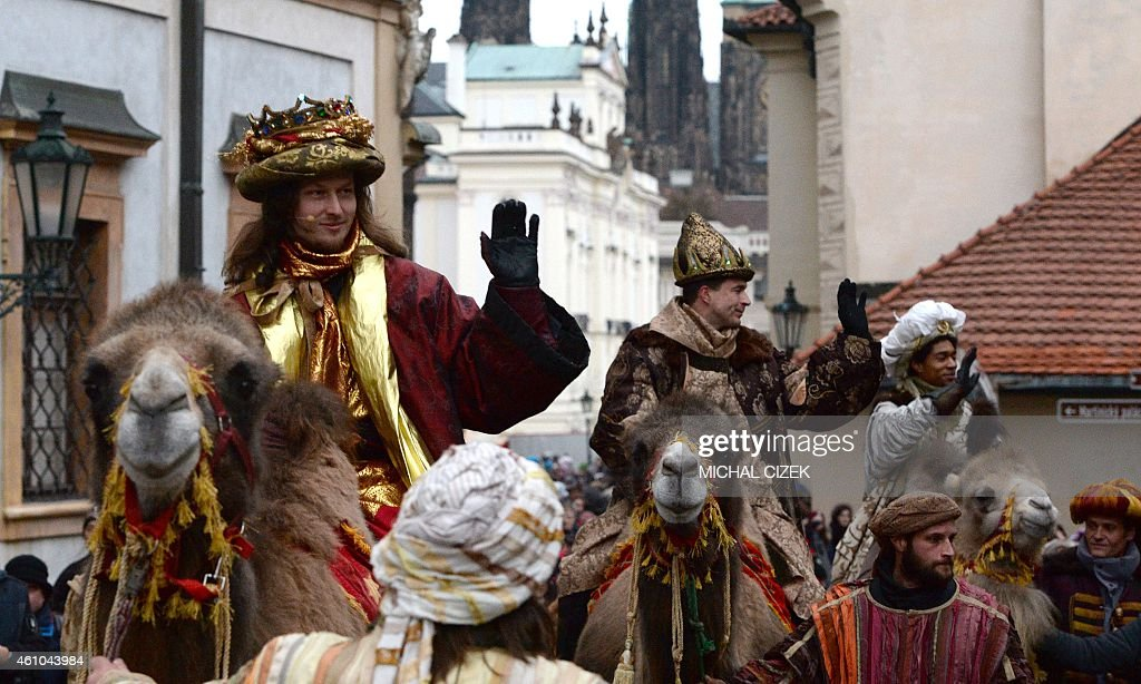 Men dressed as the Three Kings ride camels as they take part in a procession featuring the kings' journey to the Christ child born in Bethlehem on January 5, 2015 in Prague. The procession is held every year to mark Epiphany.