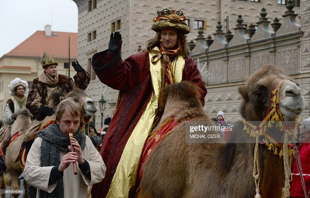 Men dressed as the Three Kings ride camels as they take part in a procession featuring the kings' journey to the Christ child born in Bethlehem on January 5, 2015 in Prague. The procession is held every year to mark Epiphany. AFP PHOTO / MICHAL CIZEK