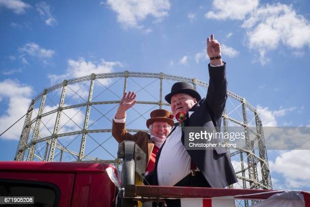Men dressed as Winston Churchill and John Bull make their way past the gasworks during the Manchester St George's Day parade through the streets on...