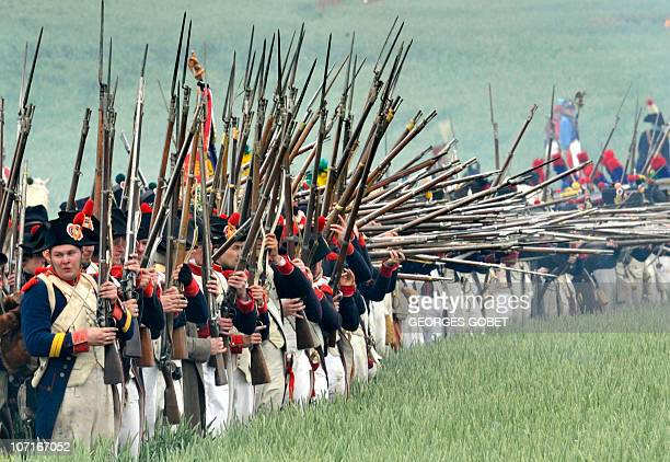 Men dressed for battle around the lion mound of the Battle of Waterloo during a reenactment of the 1815 Battle of Waterloo between the French army...